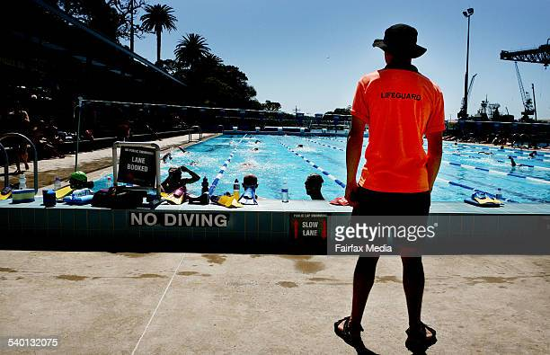 Lap swimmers in lanes are supervised by a lifeguard at the Andrew Charlton Pool in The Domain Sydney 14 October 2006 SHD Picture by FIONALEE QUIMBY