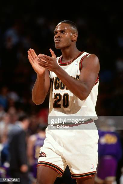 Laphonso Ellis of the Denver Nuggets claps circa 1994 at the McNichols Sports Arena in Denver Colorado NOTE TO USER User expressly acknowledges and...