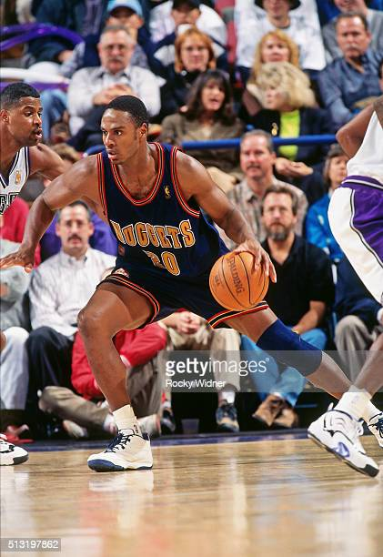 LaPhonso Ellis of the Denver Nuggets drives against the Sacramento Kings circa 1997 at Arco Arena in Sacramento California NOTE TO USER User...
