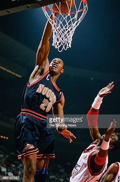 LaPhonso Ellis of the Denver Nuggets dunks during the game against the Houston Rockets on April 14 1998 at Compaq Center in Houston Texas