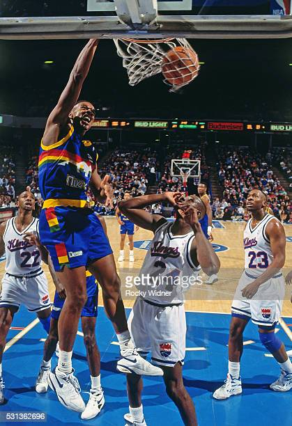 LaPhonso Ellis of the Denver Nuggets dunks the ball during a game against the Sacramento Kings circa 1993 at Arco Arena in Sacramento California NOTE...