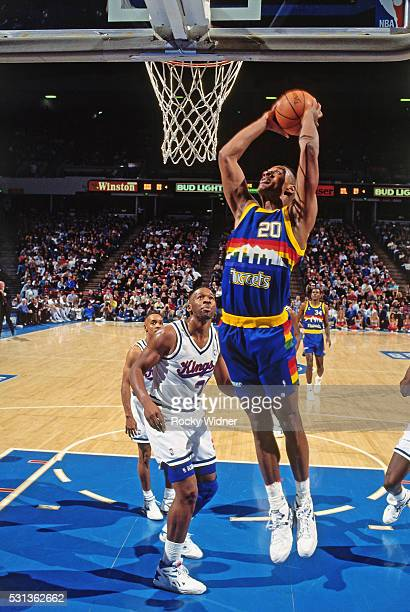 LaPhonso Ellis of the Denver Nuggets grabs a rebound during a game against the Sacramento Kings circa 1993 at Arco Arena in Sacramento California...
