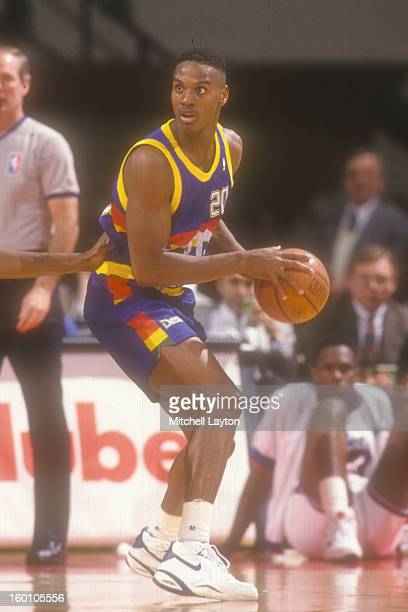 LaPhonso Ellis of the Denver Nuggets looks to make a pass during a basketball game against the Washington Bullets at the Capitol Centre on February...