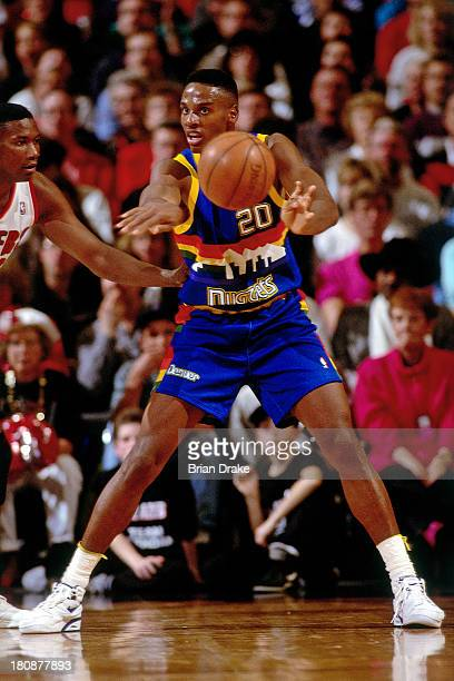LaPhonso Ellis of the Denver Nuggets passes the ball during a game played in 1992 against the Portland Trailblazers at the Veterans Memorial Coliseum...