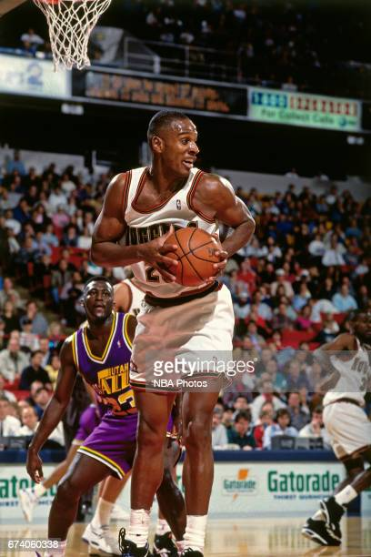 LaPhonso Ellis of the Denver Nuggets rebounds against the Utah Jazz circa 1995 at McNicholls Arena in Denver Colorado NOTE TO USER User expressly...