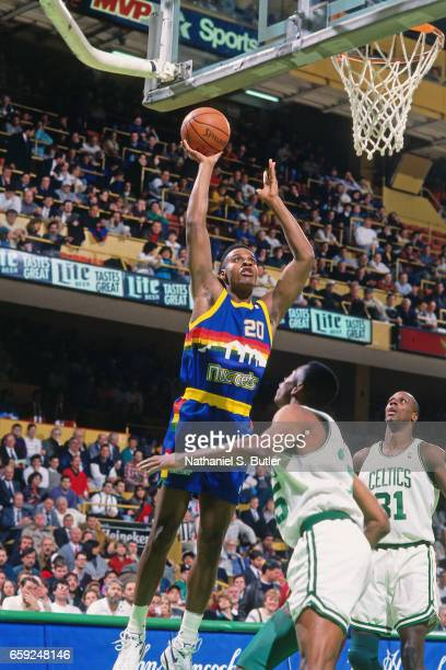 Laphonso Ellis of the Denver Nuggets shoots against the Boston Celtics circa 1993 at the Boston Garden in Boston Massachussetts NOTE TO USER User...
