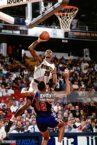 Laphonso Ellis of the Denver Nuggets shoots against the New Jersey Nets circa 1994 at the McNichols Sports Arena in Denver Colorado NOTE TO USER User...