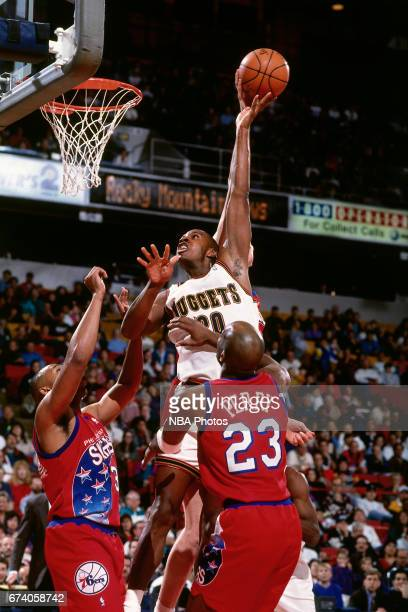 Laphonso Ellis of the Denver Nuggets shoots against the Philadelphia 76ers circa 1994 at the McNichols Sports Arena in Denver Colorado NOTE TO USER...