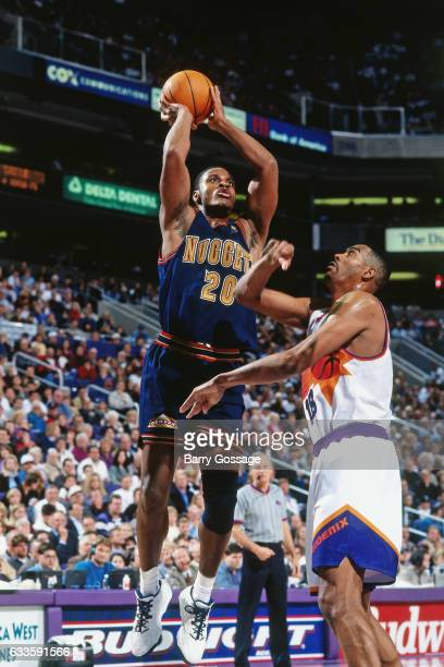 Laphonso Ellis of the Denver Nuggets shoots against the Phoenix Suns on January 14 1997 at the America West Arena in Phoenix Arizona NOTE TO USER...