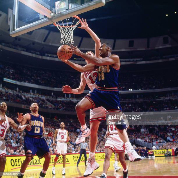 LaPhonso Ellis of the Denver Nuggets shoots the ball against the Chicago Bulls on February 18 1997 at the United Center in Chicago Illinois NOTE TO...