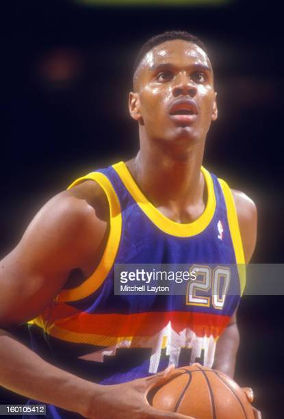 LaPhonso Ellis of the Denver Nuggets takes a foul shot during a basketball game against the Washington Bullets at the Capitol Centre on February 21...