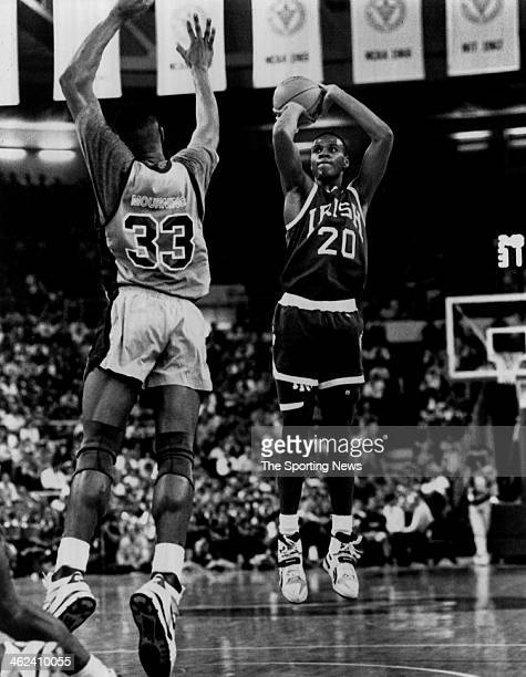 LaPhonso Ellis of the Notre Dame Fighting Irish attempts a shot against Alonzo Mourning of the Georgetown Hoyas circa 1989