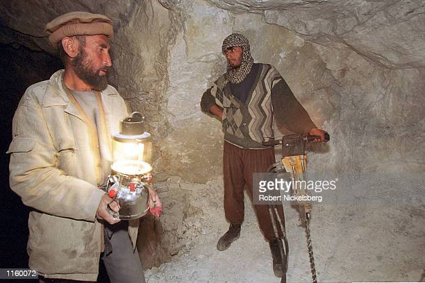 Lapis lazuli miner prepares to drill in a tunnel of the Sar-e-sang mine May 2001 in the Yamgan valley of northern Afghanistan. Afghani opposition...