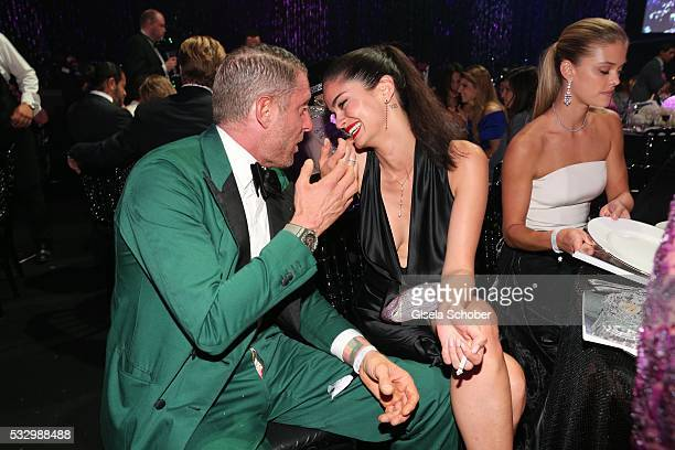 Lapo Elkann and Shermine Shahrivar attend the amfAR's 23rd Cinema Against AIDS Gala at Hotel du CapEdenRoc on May 19 2016 in Cap d'Antibes France