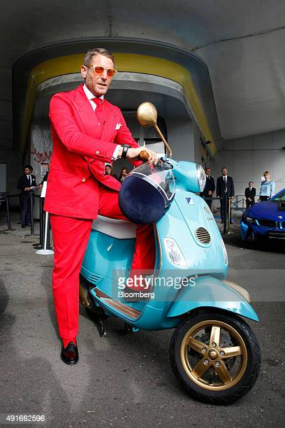 Lapo Elkann chairman of Italia Independent Group and Garage Italia Customs poses for a photograph on a Vespa scooter manufactured by Piaggio C SpA at...