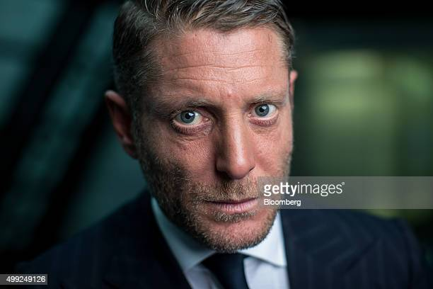 Lapo Elkann chairman of Italia Independent Group and Garage Italia Customs poses for a photograph following a Bloomberg Television interview in...