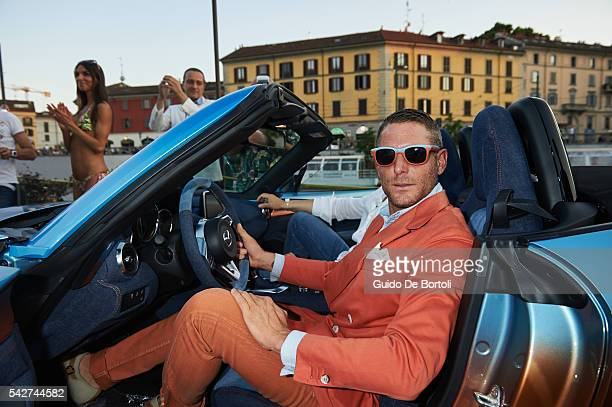 Lapo Elkann poses with the Garage Italia Customs Mazda MX5 Levanto during the Mazda Beach Party In Milan on June 23 2016 in Milan Italy