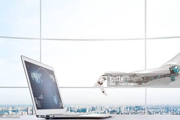 Laptop and AI robot arm