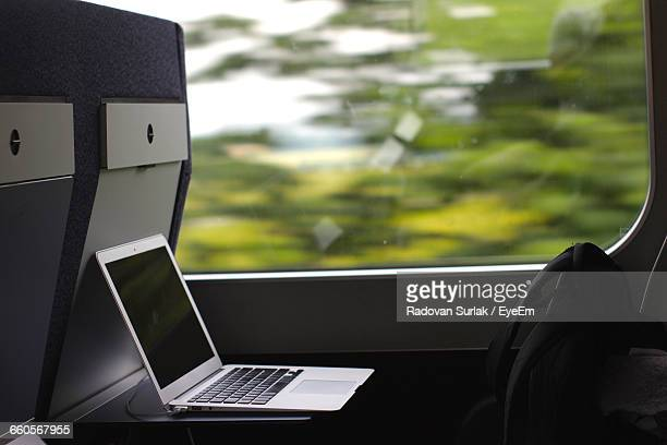 Laptop And Backpack By Window In Train