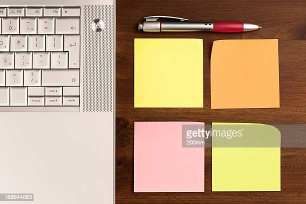 Laptop and Colorful Adhesive Notes with Pencil