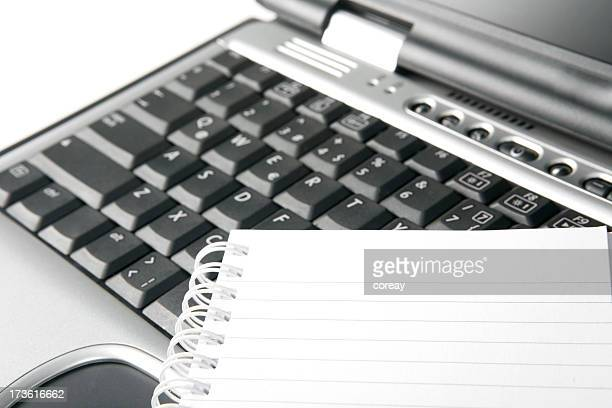 laptop and notepad - workbook stock photos and pictures