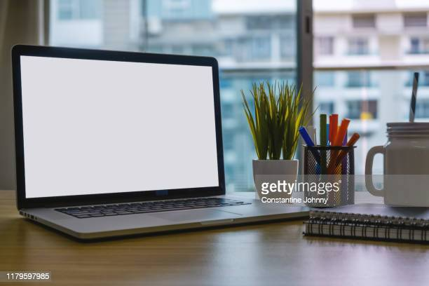 laptop and office supplies on home office desk - image stock pictures, royalty-free photos & images