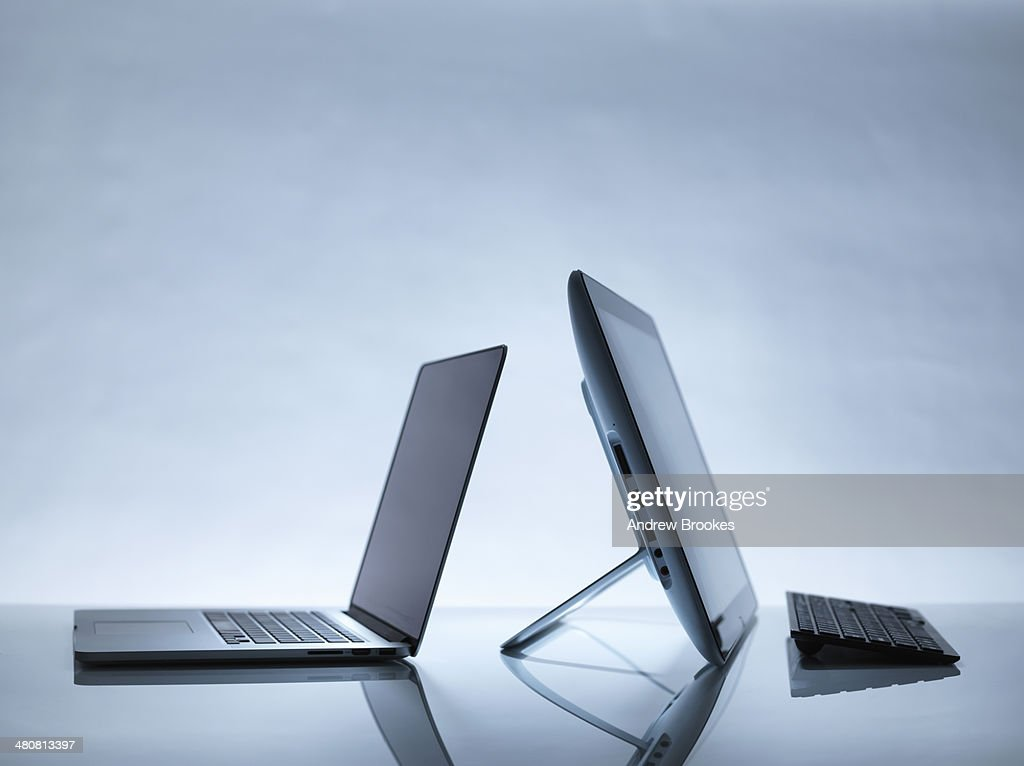 Laptop and PC on desk : Stock Photo