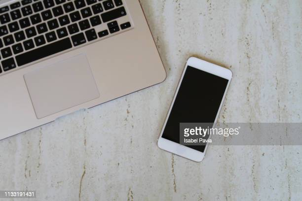 laptop and smart phone on desk - iphone mockup stock pictures, royalty-free photos & images