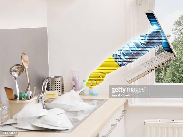 Laptop arm doing the washing up