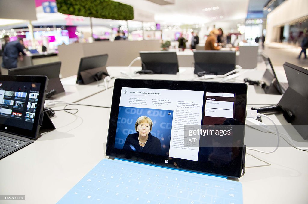 A laptop at the booth of US software company Microsoft displays a photo of German Chancellor Angela Merkel along a news text ('Merkel's word of command on gay marriage') as preparations are under way for the CeBIT high-tech fair on March 4, 2013 in Hanover, central Germany. Poland is this year's partner country of the fair running from March 5 to 9, 2013.