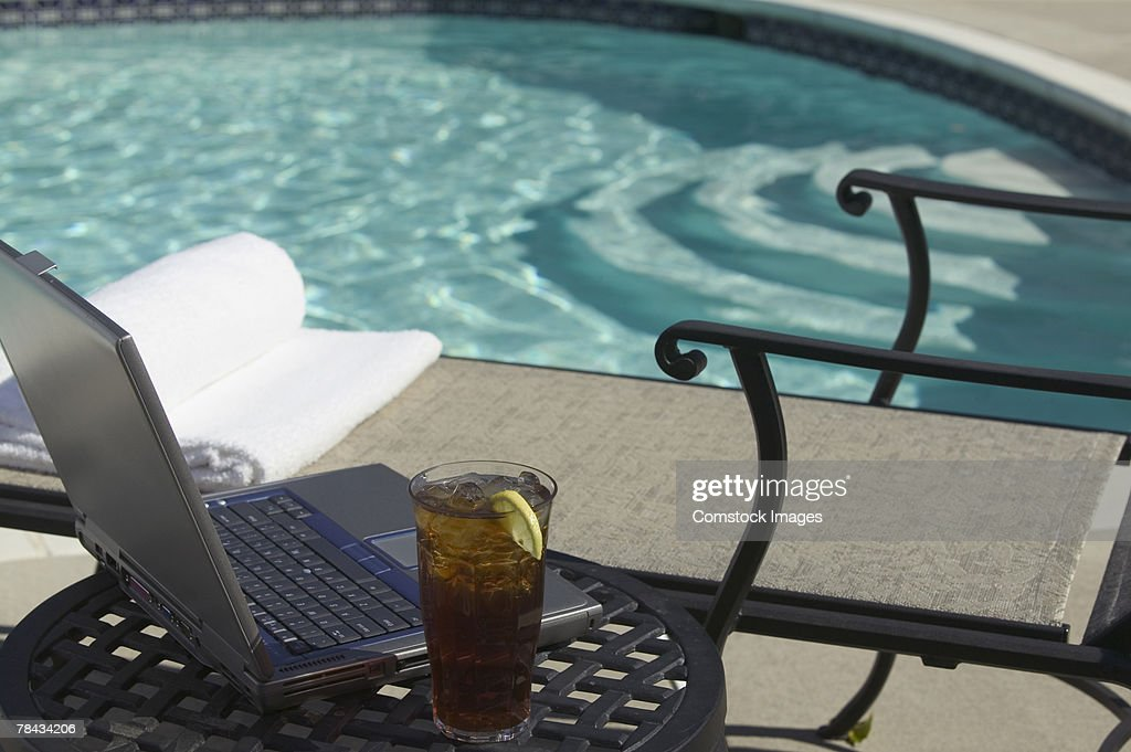 Laptop by pool : Stock Photo