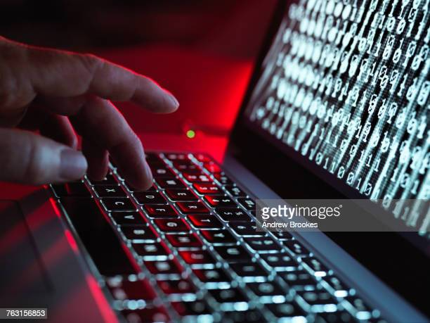 laptop computer being infected by a virus - violence stock photos and pictures