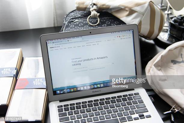 A laptop computer displays the Amazoncom Inc website at the home of a liquidation reseller in Napa California US on Friday March 11 2019 As...
