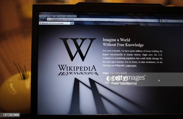 A laptop computer displays Wikipedia's front page showing a darkened logo on January 18 2012 in London England The Wikipedia website has shut down...