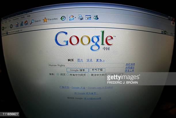 A laptop computer screen in Beijing shows the homepage of Googlecn 26 January 2006 a day after its debut in mainland China where the US online search...