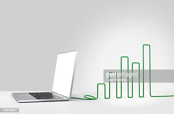 Laptop computer with cable forming a bar chart