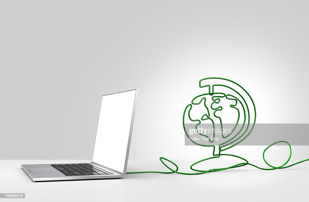 Laptop computer with cable forming a globe : Stock Photo