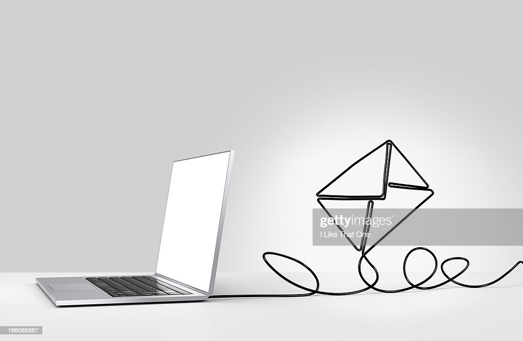 Laptop computer with cable forming a n envelope : Stock Photo