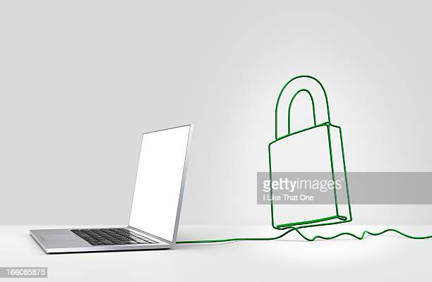 Laptop computer with cable forming a  padlock
