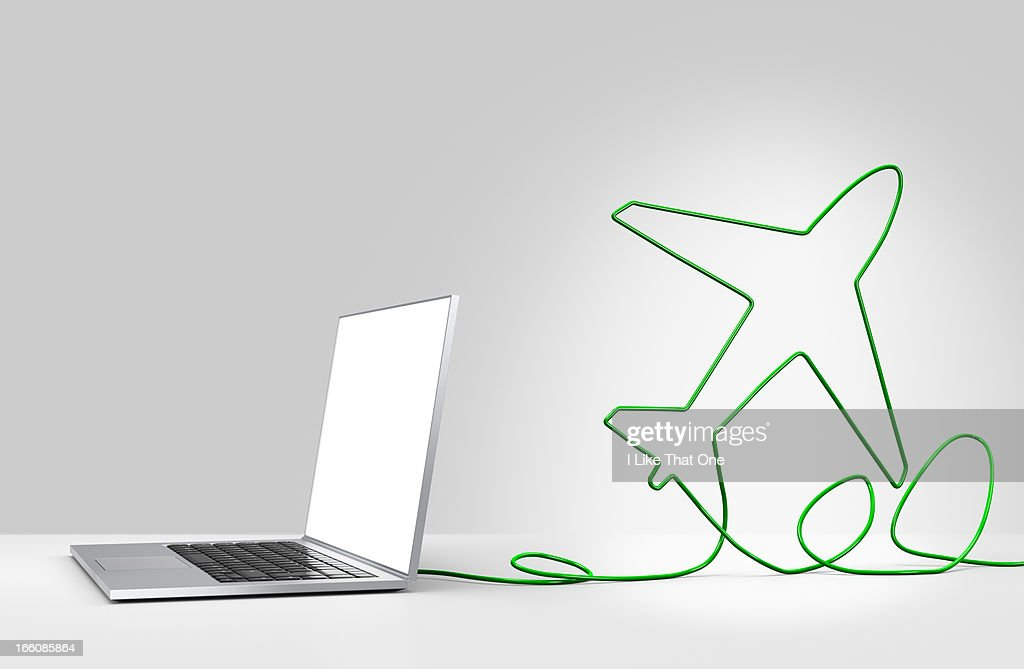 Laptop computer with cable forming a passenger jet : Stock Photo