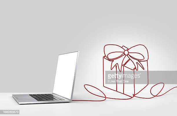 Laptop computer with cable forming a  present
