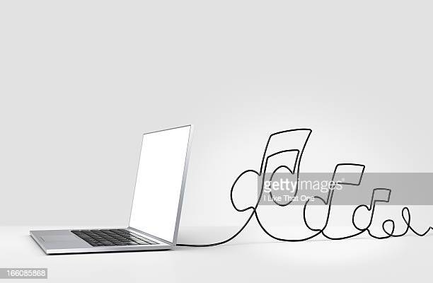 laptop computer with cable forming musical notes - musical note stock photos and pictures