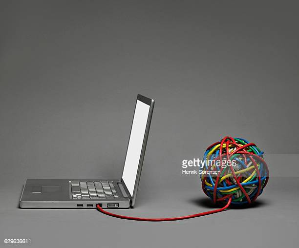Laptop connected to cable ball
