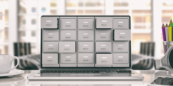Laptop data storage. Filing cabinet on a laptop screen. 3d illustration 1025773694