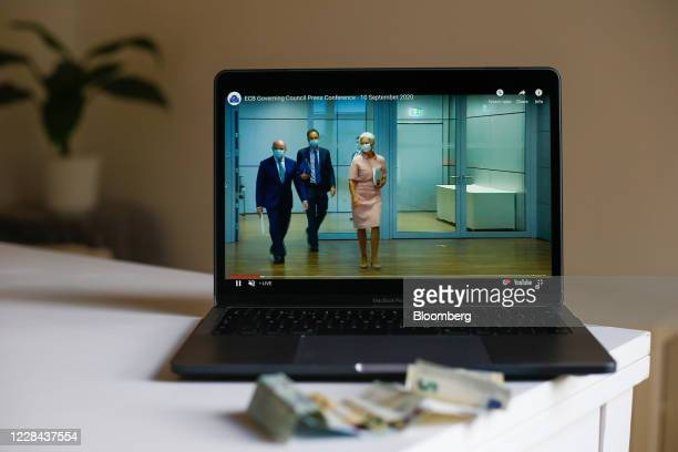A laptop displays Christine Lagarde president of the European Central Bank right arriving during a live stream video of the central bank's virtual...