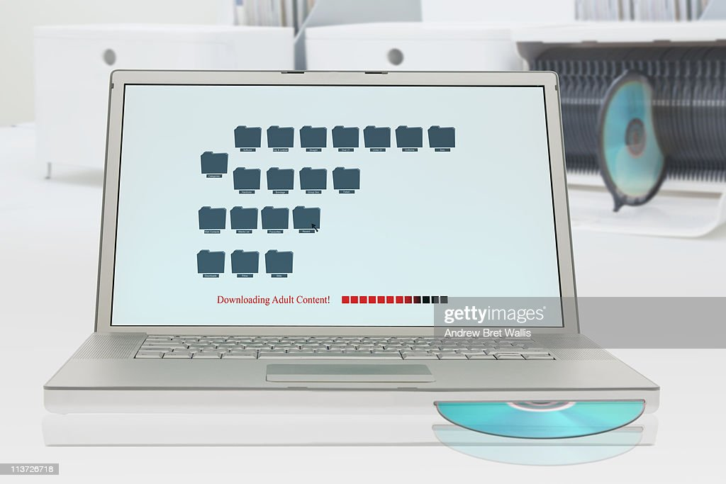 A laptop downloading adult content : Stock Photo