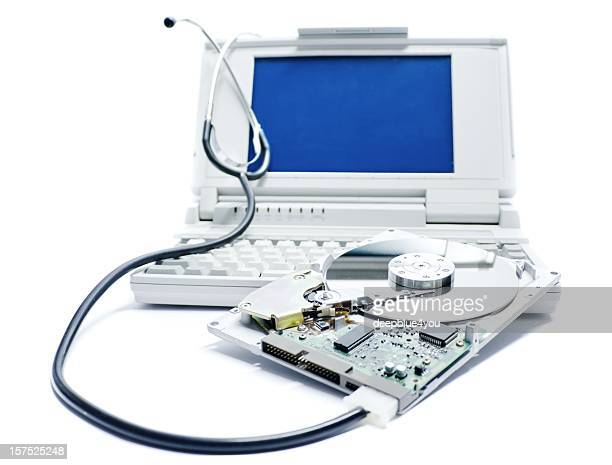 A laptop hard drive being repaired