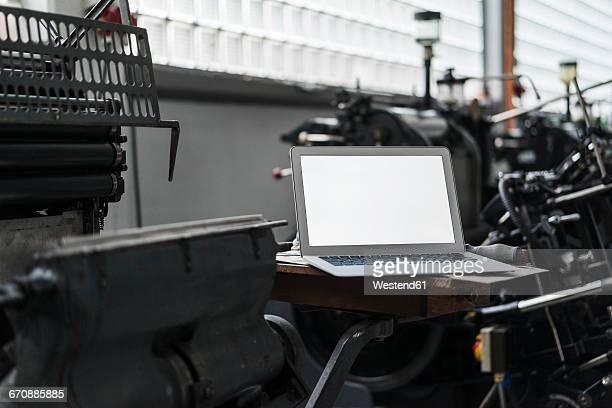 Laptop in printing shop