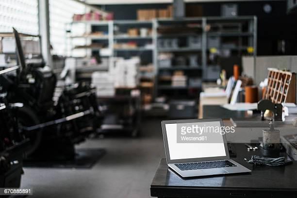 Laptop in typesetting shop