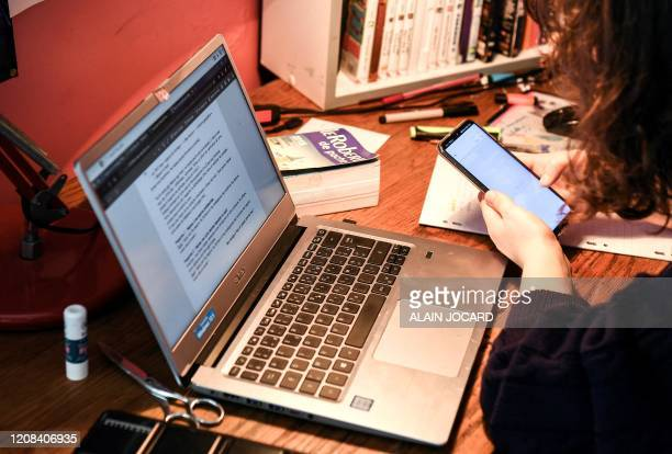A laptop is pictured as a high school student takes a test online at her home in Chisseaux near Tours on March 27 on the eleventh day of a lockdown...